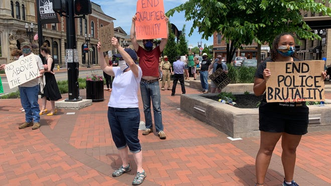 Protesters gather on the square in downtown Wooster to support the fight against police brutality and racial inequality.