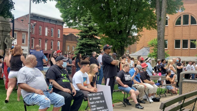 A crowd gathers at the courthouse square to listen to community leaders speak before taking to the sidewalk for a peaceful Black Lives Matter rally Saturday afternoon