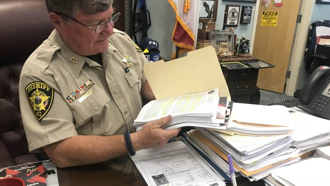 Sheriff Hans Miller reviews the paperwork detailing the Governor's Highway Safety Commission Grant, which will allow the sheriff's office to form a DWI task force beginning October 2018.