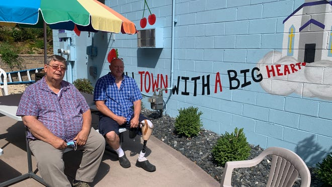 The Server volunteers Bob Ludolph and Ron Woodward sit on the patio outside the community cafe. The patio was completed last fall and has provided outdoor seating for The Server while the inside is closed due to the pandemic