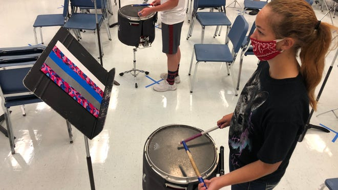 Josie Tish plays a snare drum during Tuesday's small-group band practice at West Holmes High School.