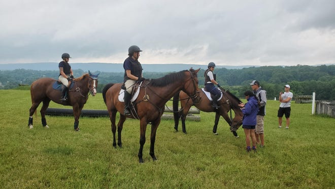 U.S. Olympian Body Martin, second from right, delivers instructions to three riders on the cross-country grounds at Mountainview Farm in Branchville on June 27. It was Martin's first in a series of three clinics at the farm this summer.