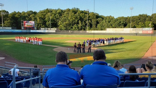 The Bergen Catholic and Cranford baseball teams line the third- and first-base lines, respectively, prior to the North Region championship of the Last Dance World Series on Wednesday night at Skylands Stadium in Frankford. Cranford won the game, 10-0, in six innings.
