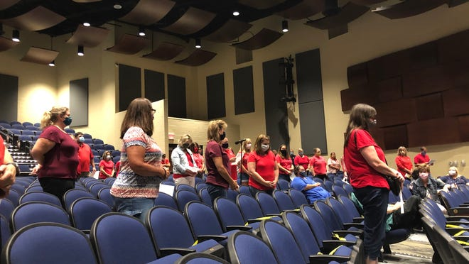 Over 70 Streetsboro teachers and staff members stand in solidarity as Streetsboro Education Association President John Oleksa urges the Board of Education to implement a fully digital learning model for at least the first grading period.