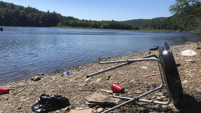 An abandoned grill is surrounded by trash along the Delaware River near Point of Gap Overlook on Wednesday, July 29.
