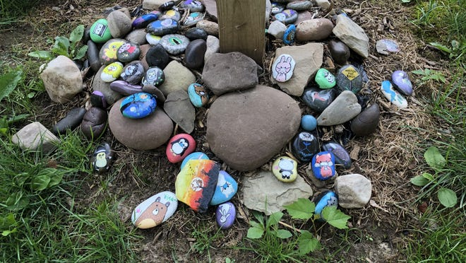 If you're stuck inside because of rain today, paint some rocks and brighten the day of those who pass by.
