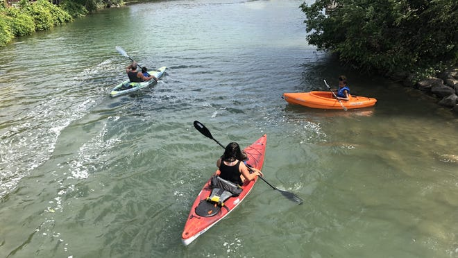 A group of kayyakers head for the Canandagua Lake Outlet on Tuesday.