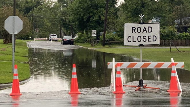 School Street at Henderson Dr in Jacksonville closed due to flooding from recent thunderstorms.