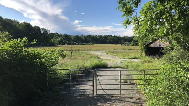 A gate is closed on an entrance to the former Newton Airport property on Stickles Pond Road in Andover Township, a site for which BHT Properties has applied to use as an auto auction and storage facility. The application was postponed to Aug. 18 at the Andover Township Land Use Board meeting Tuesday night.