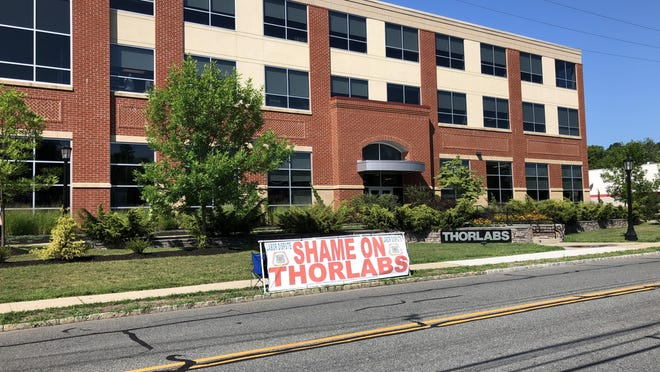 A banner created by Carpenters Local 254 is seen in front of the Thorlabs headquarters building on Sparta Avenue in Newton Wednesday, Aug. 5.