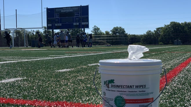 The Pocono Mountain West High School football team practices on Thursday, Aug. 20, while implementing safety regulations amidst the COVID-19 pandemic. On Friday, the PIAA voted to move ahead with fall sports.