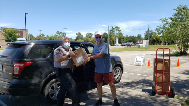 Jim Hock, Burgaw Chief of Police came and loaded up seven boxes for his officers to redistribute.