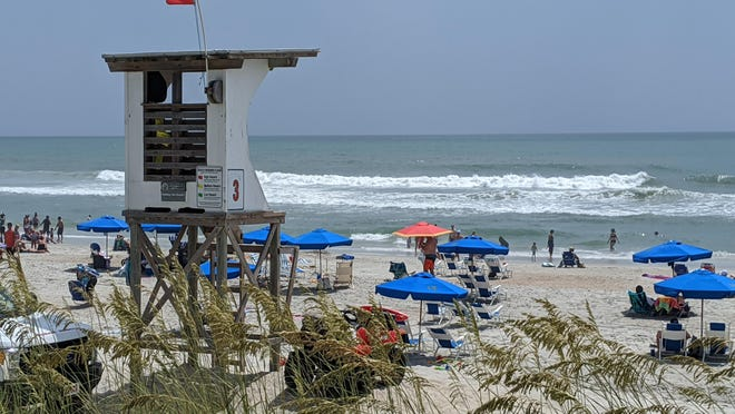 Red warning flags were out in Wrightsville Beach, N.C., Saturday due to the heavy surf and danger of rip currents as the outer swells of Hurricane Isaias began impacting the Carolinas.
