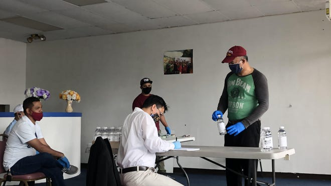 The Bhutanese Community Association of Akron organized a mask and hand sanitizer distribution program for the public May 24, 2020.