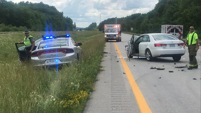 Emergency responders work at the scene of a fatal accident on Interstate 77 Monday afternoon. An 81-year-old Pleasant City resident died at Southeastern Med in Cambridge while the other driver was flown to Ohio Health's Grant Medical Center in Columbus with serious injuries.