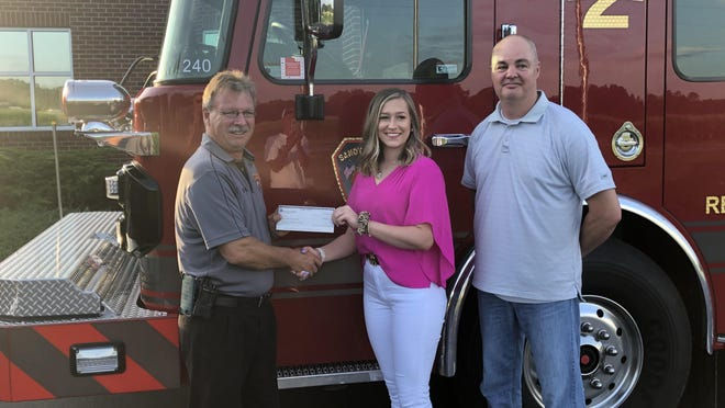 Taylor Jordy, a senior from North Lenoir High School, was recently awarded the 2020 Ashton Rhodes Memorial Scholarship, presented by Sandy Bottom VFD and the Rhodes Family. Pictured from left: Jimmy Stroud of Sandy Bottom VFD, Taylor and her father, Kent Bennett.