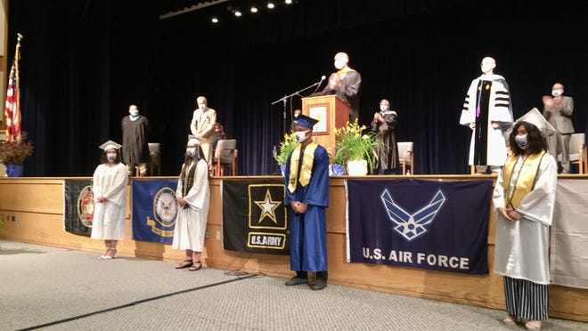 Pleasant Valley High School seniors Christal Awe, Madison Beerwa, Ismael Cenexant and Deven Venegas participated in a special graduation ceremony Wednesday night at the school's auditorium. The four students will be shipping out to begin training for military careers before the school's scheduled commencement in July, so a small ceremony was held to honor the accomplishments of these Bears.