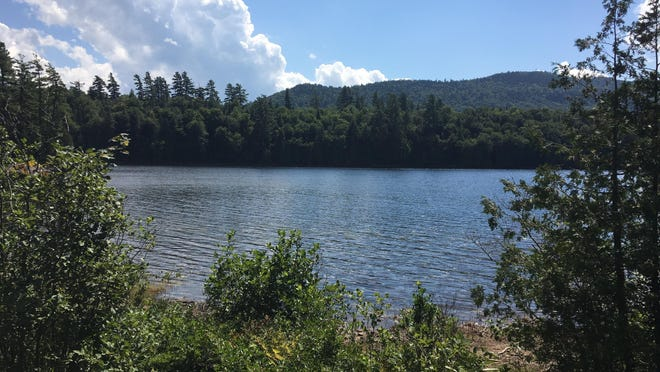 A serene moment at Rich Lake which is just south of the High Peaks area of the Adirondacks. Despite the coronavirus pandemic, the High Peaks region appears to be seeing more visitors than ever this summer.