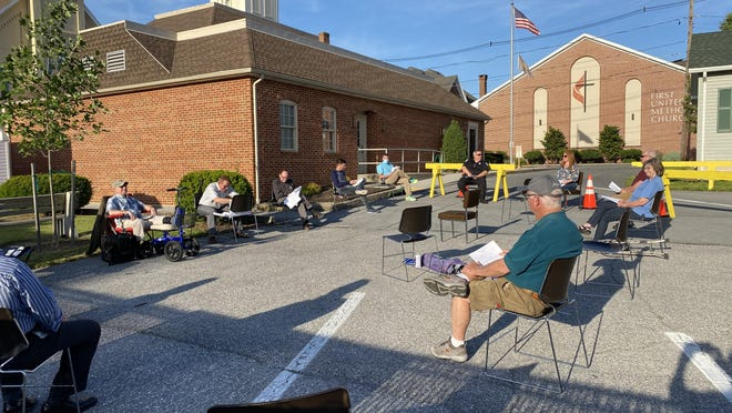 This week's Greencastle Borough Council meeting was held on the borough hall parking lot, with 25 chairs placed for social distancing and limits on large gatherings under state COVID-19 guidelines. SHAWN HARDY/THE RECORD HERALD