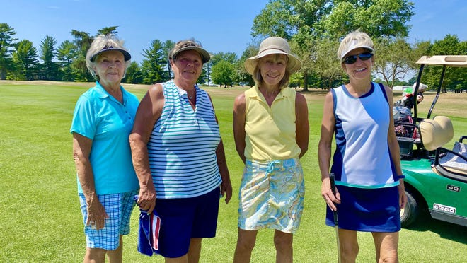 Suzie Morris, left, and her friends Mary Frank, Maxine Beck and Peggy Walsh enjoy a round of golf at the Waynesboro Country Club. JOHN IRWIN/ THE RECORD HERALD