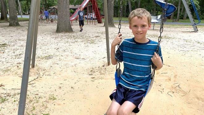 Nathan Lander, 9, of Mercersburg, enjoys an afternoon at Red Run Park in Rouzerville while swinging on the swing set.