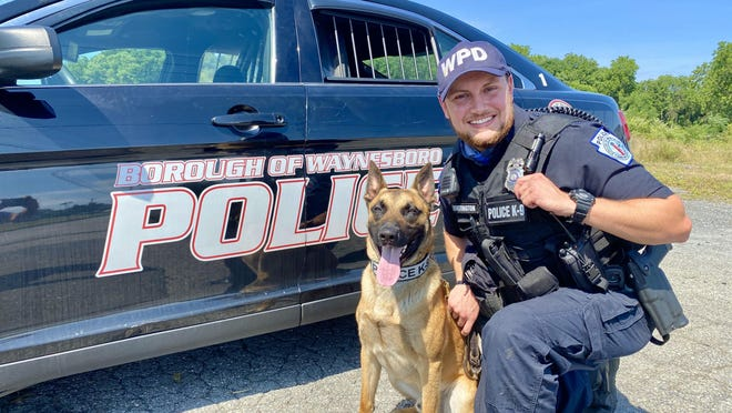 Officer Huntington and his K-9 Bushta are pictured here next to a Waynesboro Police Department  patrol car.