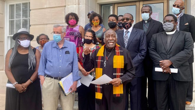 Members of the newly created Wilmington NC Clergy Truth and Reconciliation Mission gathered on the steps of the Alton Lennon Federal Building in downtown Wilmington on Monday before filing a complaint with the U.S. Department of Justice against the three Wilmington Police Department officers fired for racist speech caught on video.