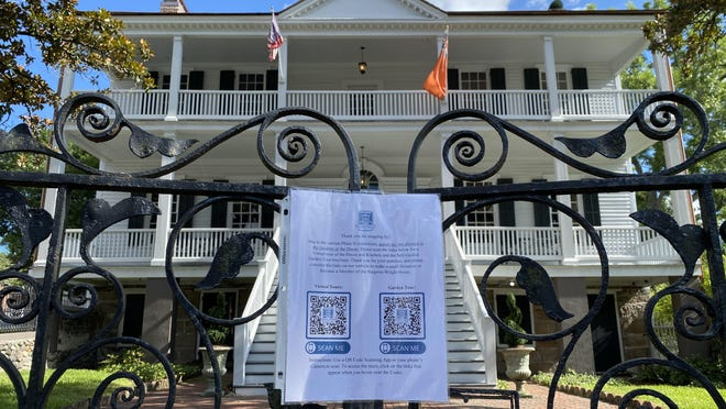 A sign on the front gate at the Burgwin-Wright House in downtown Wilmington informs visitors the house is closed to tours until Phase 3 of the state's COVID-19 reopening plan.
