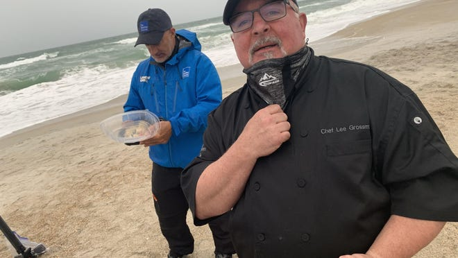 Lee Grossman, owner of the Bento Box, brings Weather Channel meteorologist Jim Cantore a snack in between his live appearances Monday evening at Wrightsville Beach in advance of the arrival of Tropical Storm Isaias..