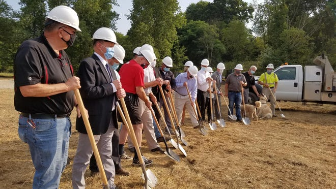 New Philadelphia city officials, park board representatives, contractors and others participate in Tuesday's ceremonial groundbreaking at Southside Community Park.