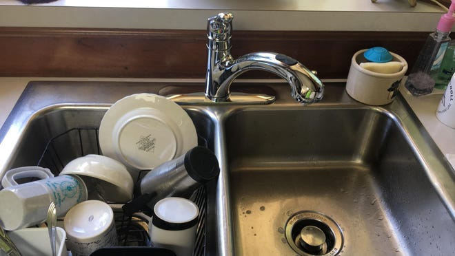 A new faucet took more time to buy than to install. It includes a built-in sprayer to rinse dishes, fruits and vegetables.