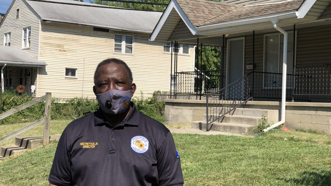 Columbus public safety director Ned Pettus Jr. stands outside the home he grew up on the 1000 block of East 20th Avenue in South Linden.