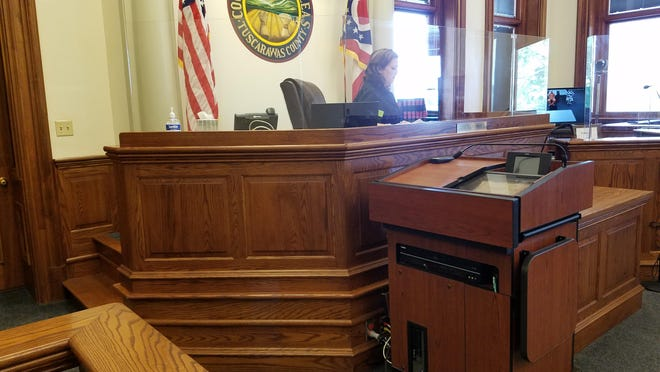 Tuscarawas County Common Pleas Judge Elizabeth Lehigh Thomakos presides over the arraignment of Michael A. Lynch on Monday.  Lynch can be seen on the video monitor at right.