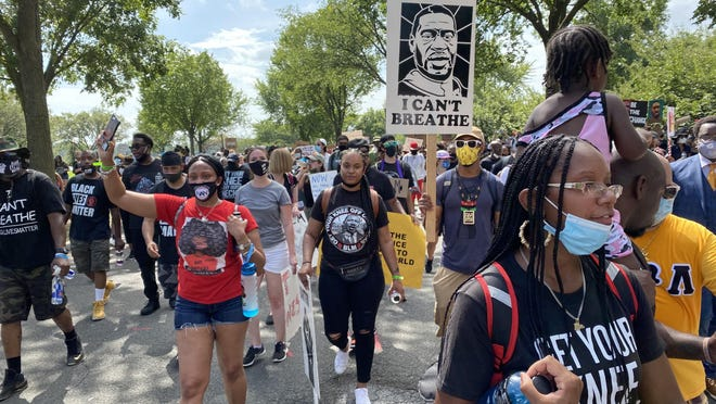 March participants walk from the Lincoln Memorial down Ohio Drive Southwest to the Martin Luther King Jr. Memorial during the March on Washington on Friday.