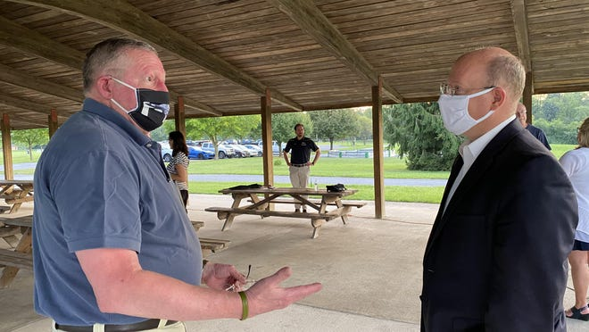 Chris Richwine of Waynesboro talked with state Rep. Paul Schemel after Tuesday evening's town hall in a pavilion at Antrim Township Community Park. SHAWN HARDY/THE RECORD HERALD