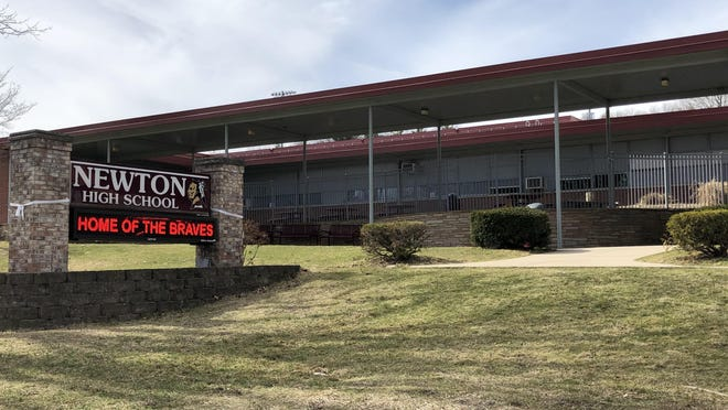 Students attending Newton Public Schools, including Newton High School, seen here in March, will start the school year with fully remote instruction.