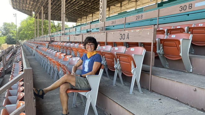 Shari Giordano, a longtime staff member at the Colorado State Fair, sits in the empty, historic grandstands. This year's Fair is a far cry from years past because COVID-19 has forced organizers to rethink the popular community event and there is clearly a difference.