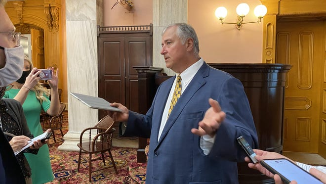 Ex-Ohio House Speaker Larry Householder talks to the press outside of the House of Representatives in th Ohio Statehouse after returning for the first time since being charged in a $60 million bribery scandal.