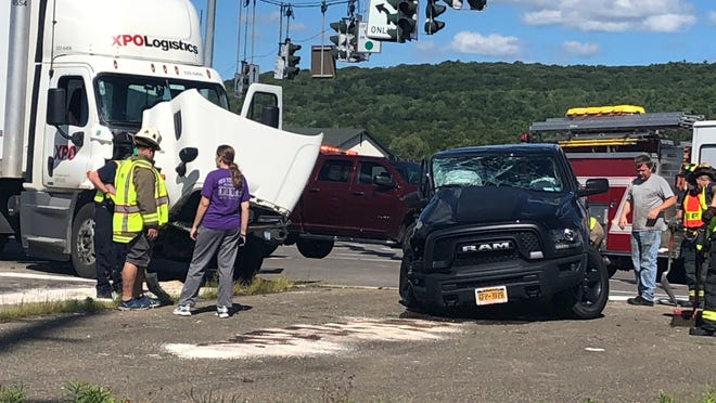 Local emergency responders work the scene of a two-vehicle accident Friday afternoon near the Hornell Plaza entrance off Route 36.