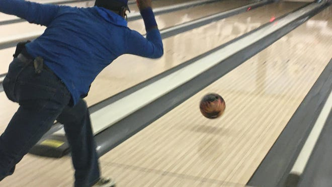 Warner Murphy, the daytime front desk associate for Norwich Bowling and Entertainment Center, bowls on Friday. Employees are working to make sure the alley is safe for customers when it reopens.