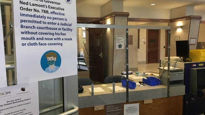 New safety rules and plexiglass barriers greet visitors at Danielson Superior Court on Monday, the first day the building has been open to the public since late March.