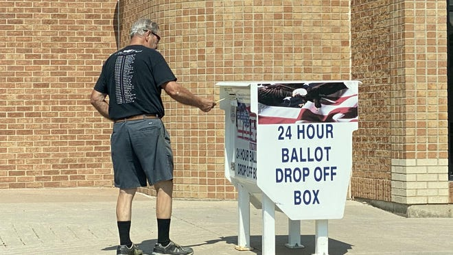 A Pueblo voter casts a mail-in ballot Wednesday at a 24-hour drop-off box the Lamb Branch Library, 2525 S. Pueblo Blvd., on Pueblo's South Side.