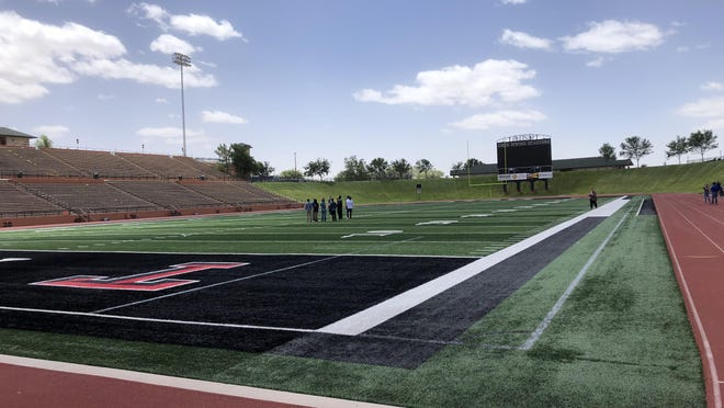 Amarillo ISD administrators, as well as students and administrators from Caprock High School, prepare for Tuesday evening's in-person commencement ceremony at Dick Bivins Stadium.