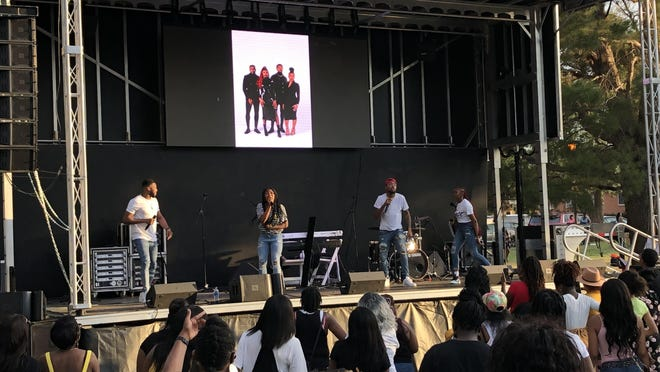 The Walls Group gets the crowd moving during their free concert, which closed the Juneteenth celebration at Bones Hooks Park Saturday evening.