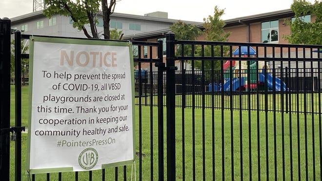 A Van Buren Buren School District sign notes that playgrounds are closed to mitigate COVID-19 exposure.