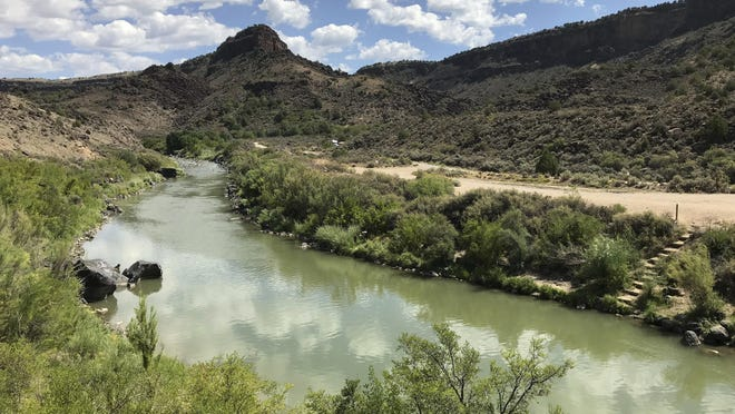 This Aug. 6, 2018 photo shows the Rio Grande flowing south of Taos, New Mexico. A recent report by the U.S. Geological Survey found that investments made to reduce the risk of wildfire and to protect water sources in the West are paying dividends by creating jobs and infusing money into local economies. The study focused on several counties along the New Mexico-Colorado border that make up the watershed of the Rio Grande, one of North America's longest rivers.