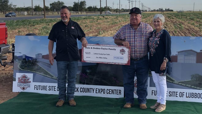Dale and Debbie Taylor present a $1 million check to Bret Lamkin (left) for the Lubbock County Expo Center.