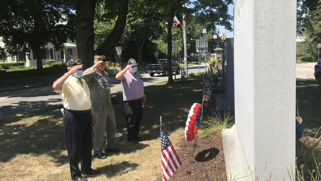 From left, Walter Way and Tom LaFreniere, two Korean War veterans, and John Blackburn, a Vietnam War veteran, place a wreath at the base of the Korean War Memorial on Chelsea Parade on Sunday in Norwich.