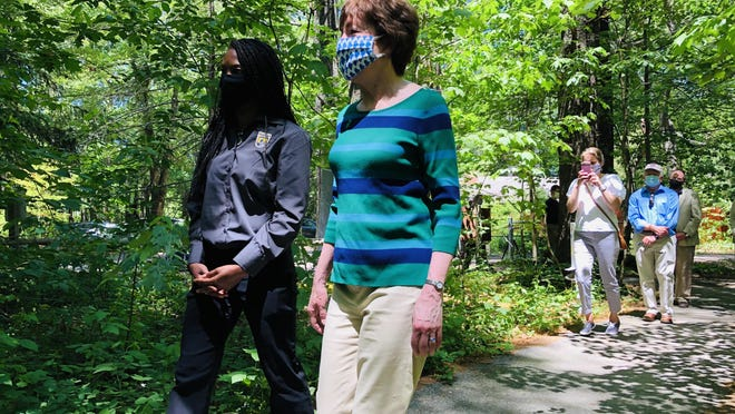 Aurelia Skipwith, left, the director of the U.S. Fish and Wildlife Service, and Sen. Susan Collins embark on a walk along the Carson Trail in Wells on Friday, June 19.
