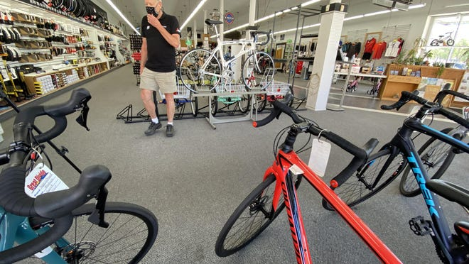 Lee Newhart, owner of Great Divide Ski Bike and Hike, stands in the showroom at his bicycle shop, 400 N. Santa Fe Ave. The demand for new bikes is much higher than the supply because of the COVID-19 pandemic.